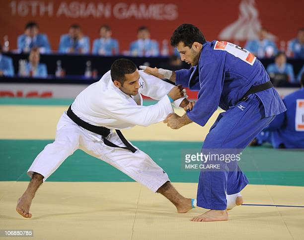 Kuwait's Elish Kh Y Y A Alali fights Iran's Arash Miresmaeili in the men's 66kg category of judo at the 16th Asian Games in Guangzhou on November 15...