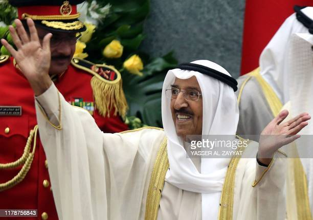 Kuwait's Emir Sheikh Sabah al-Ahmad Al-Sabah waves upon his arrival to open the parliament's new term at the Gulf emirate's National Assembly in...