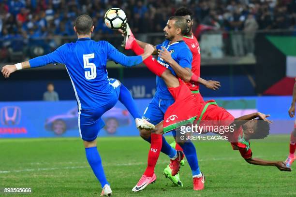 Kuwait's Fahad alHajiri vies for the ball with Oman's Raed Ibrahim Saleh during the 2017 Gulf Cup of Nations football match between Kuwait and Oman...