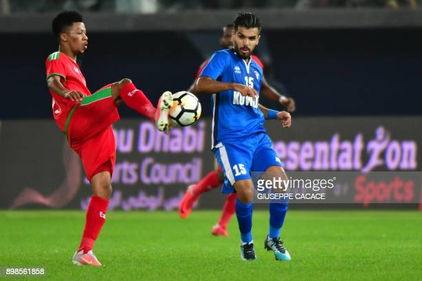 Kuwait's Faisal Harbi vies for the ball with Oman's Jameel Al-Yahmadi during the 2017 Gulf Cup of Nations football match between Kuwait and Oman at...