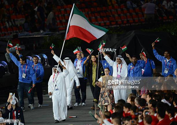 Kuwait's flagbearer Fehaid Aldeehani leads his delegation as they parade during the opening ceremony of the London 2012 Olympic Games in the Olympic...