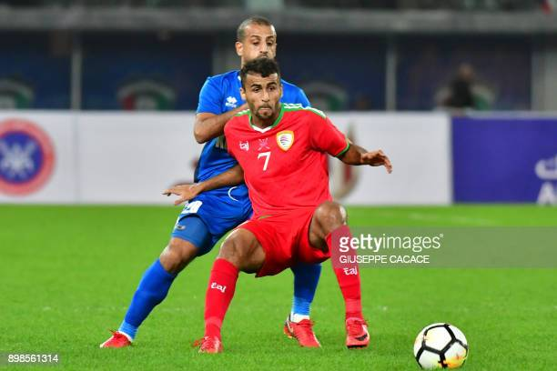 Kuwait's Hussein Hakim vies for the ball with Oman's forward Khalid AlHajri during the 2017 Gulf Cup of Nations football match between Kuwait and...