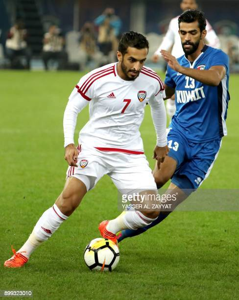 Kuwait's Khaled alQahtani vies for the ball against Emirati player Ali Mabkhout during the Gulf Cup football match between Kuwait and the UAE at the...