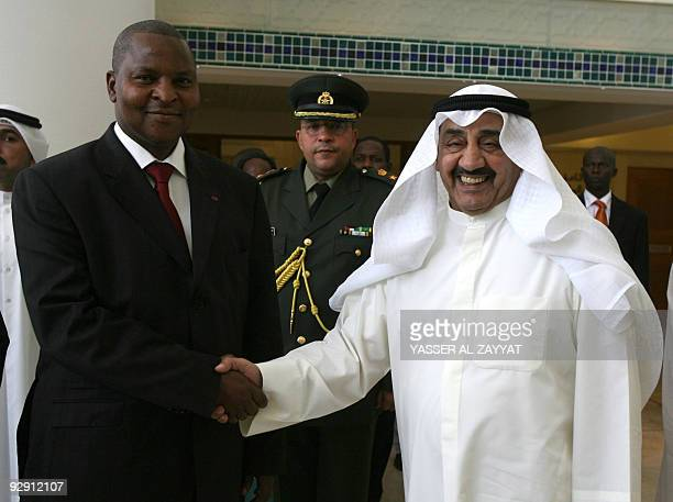 Kuwait's national assembly speaker Jassem alKharafi shakes hands with Prime Minister of the Central African Republic FaustinArchange Touadera upon...