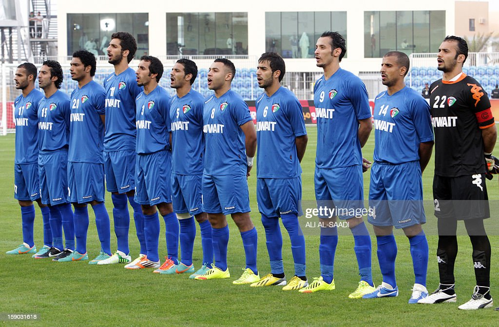 Kuwait's national team players line-up prior to the start of their Gulf Cup football match Kuwait versus Yemen, on January 6, 2013, in the Bahraini capital, Manama.