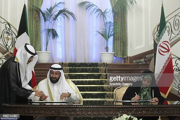 Kuwait's Oil Ministe Ali Saleh Al Omeir and Irans Vice President and Head of Environmental Protection Organization Masoumeh Ebtekar sign agreements...