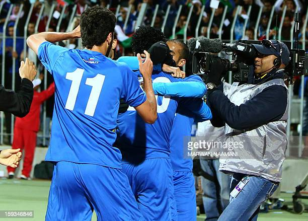 Kuwait's players celebrate after Yousef alSulaiman scored a goal during their Gulf Cup football match Kuwait against Saudi Arabia on January 12 2013...