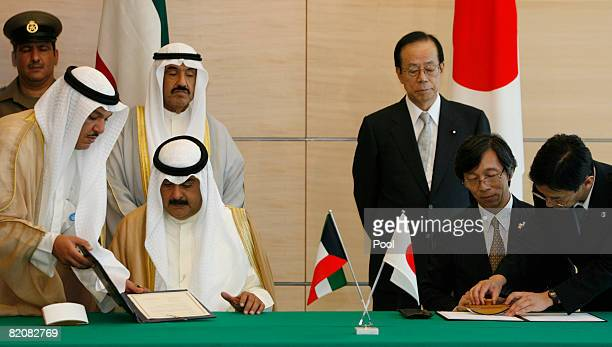 Kuwait's Prime Minister Sheikh Naser Mohammed alSabah and Japan's counterpart Yasuo Fukuda look on as Kuwaiti foreign ministry undersecretary Khaled...