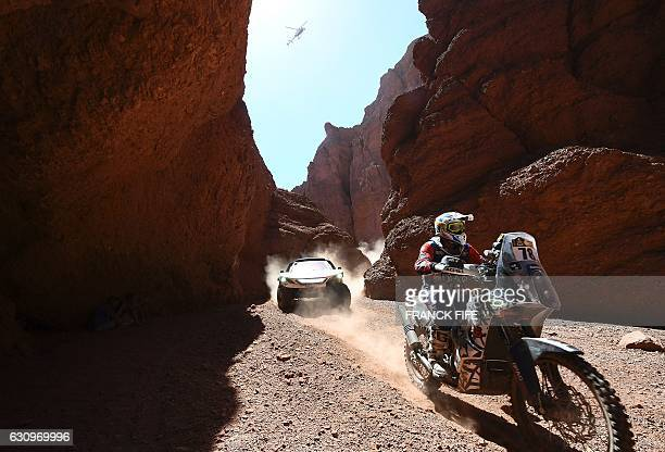 TOPSHOT Kuwait's rider Ibraheem Alrubaian powers his KTM followed by Peugeot's Spanish drivers Carlos Sainz and Lucas Cruz during the Stage 3 of the...