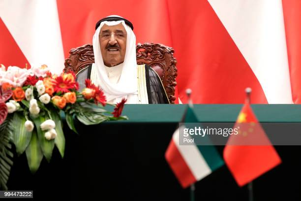 Kuwait's ruling emir Sheikh Sabah Al Ahmad Al Sabah looks as he witnesses a signing ceremony with Chinese President Xi Jinping at the Great Hall of...