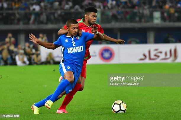 Kuwait's Sami mohammed alSane vies for the ball with Oman's Raed Ibrahim Saleh during the 2017 Gulf Cup of Nations football match between Kuwait and...