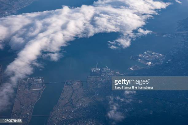 Kuwana city and Kawagoe town in Mie prefecture in Japan sunset time aerial view from airplane
