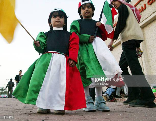 Kuwati children dress in the colors of the Kuwaiti flag while celebrating National Day February 25, 2003 in Kuwait City, Kuwait. The day marks the...