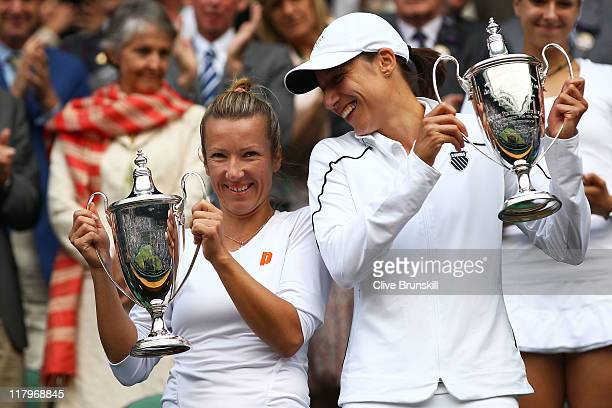 Kveta Peschke of the Czech Republic and Katarina Srebotnik of Slovenia hold up their championship trophies after winning their final round Ladies'...