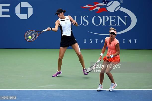 Kveta Peschke of the Czech Republic and Katarina Srebotnik of Slovenia return a shot against Martina Hingis of Switzerland and Flavia Pennetta of...