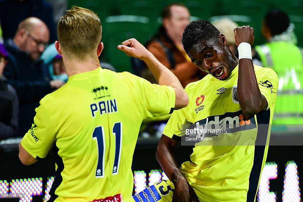 Kwabena Appiah and Connor Pain of the Central Coast Mariners celebrate the come from behind draw with a dance during the round one A-League match between the Perth Glory and the Central Coast Mariners at nib Stadium on October 8, 2016 in Perth, Australia.