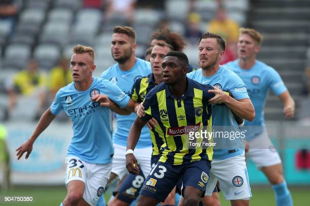 Kwabena Appiah of the Mariners backs into the City wall during the round 16 ALeague match between the Central Coast Mariners and Melbourne City at...