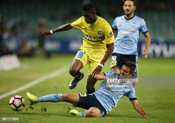 Kwabena Appiah of the Mariners is tackled by Michael Zullo of Sydney FC during the round 23 ALeague match between Sydney FC and the Central Coast...