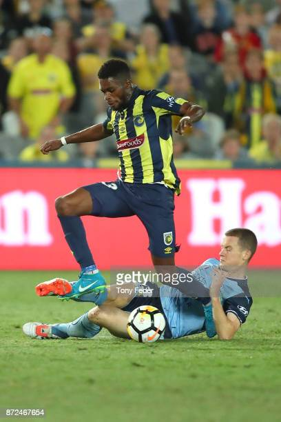 Kwabena Appiah of the Mariners leaps over Brandon O'Neill of Sydney FC during the round six ALeague match between the Central Coast Mariners and...
