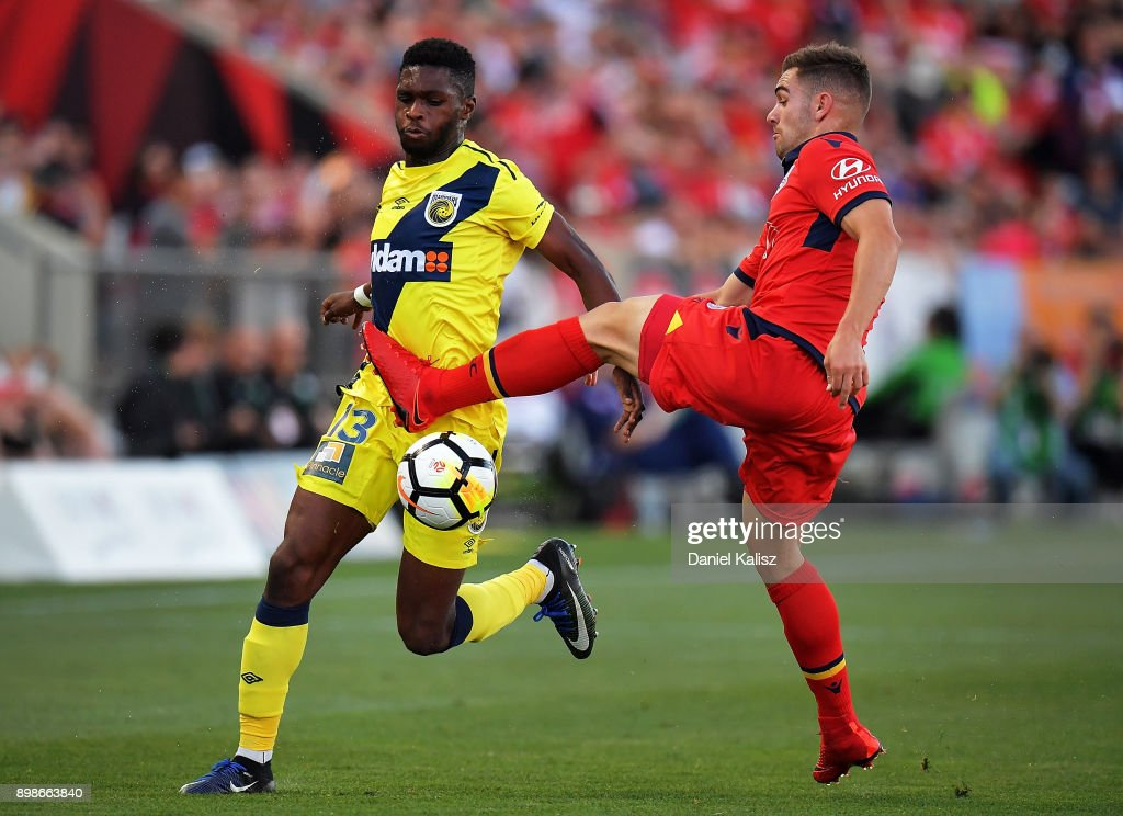 Kwabena Appiah-Kubi of the Mariners and Benjamin Garuccio of United compete for the ball during the round 12 A-League match between Adelaide United and the Central Coast Mariners at Coopers Stadium on December 26, 2017 in Adelaide, Australia.