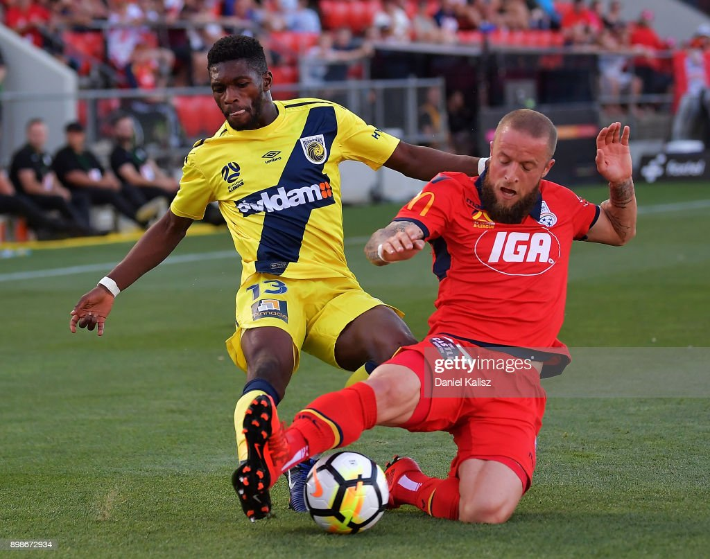 Kwabena Appiah-Kubi of the Mariners competes for the ball with Daniel Adlung of United during the round 12 A-League match between Adelaide United and the Central Coast Mariners at Coopers Stadium on December 26, 2017 in Adelaide, Australia.
