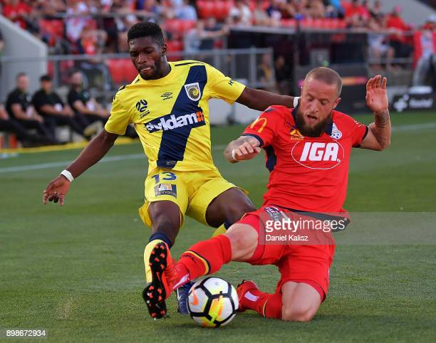 Kwabena AppiahKubi of the Mariners competes for the ball with Daniel Adlung of United during the round 12 ALeague match between Adelaide United and...