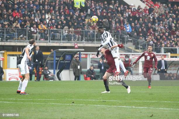 Kwadwo Asamoah and Andrea Belotti compete for the balla during the Serie A football match between Torino FC and Juventus FC at Olympic Grande Torino...