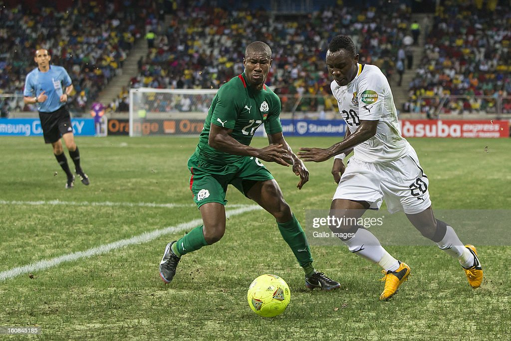 Kwadwo Asamoah from Ghana (R) and N Prejuce Nakoulma from Burkina Faso compete for the ball during the 2013 Orange African Cup of Nations 2nd Semi Final match between Burkina Faso and Ghana at Mbombela Stadium on February 06, 2013 in Nelspruit, South Africa.