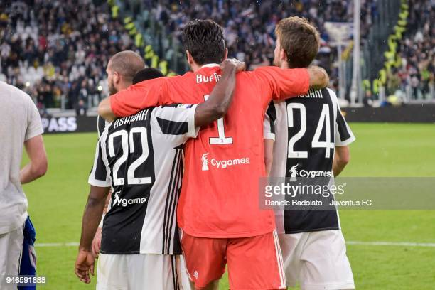 Kwadwo Asamoah Gianluigi Buffon and Daniele Rugani of Juventus celebrate the victory at the end of the serie A match between Juventus and UC...