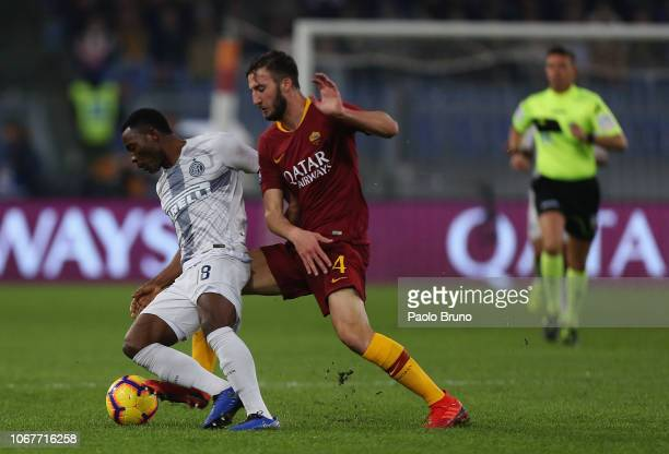 Kwadwo Asamoah of FC Internazionale competes for the ball with Bryan Cristante of AS Roma during the Serie A match between AS Roma and FC...