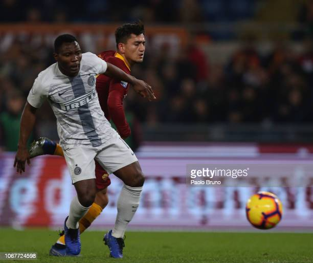 Kwadwo Asamoah of FC Internazionale competes for the ball with Gengiz Under of AS Roma during the Serie A match between AS Roma and FC Internazionale...
