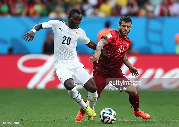 Kwadwo Asamoah of Ghana and Vieirinha of Portugal compete for the ball during the 2014 FIFA World Cup Brazil Group G match between Portugal and Ghana...