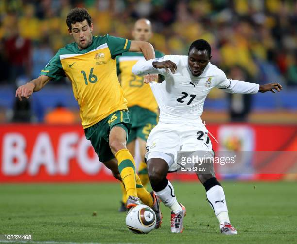 Kwadwo Asamoah of Ghana is challenged by Carl Valeri of Australia during the 2010 FIFA World Cup South Africa Group D match between Ghana and...