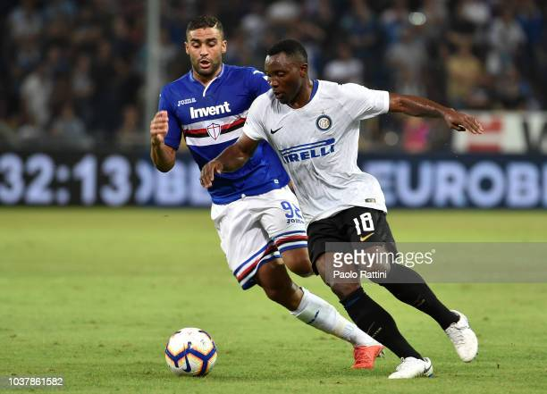 Kwadwo Asamoah of Inter and Gregoire Defrel of Sampdoria during the serie A match between UC Sampdoria and FC Internazionale at Stadio Luigi Ferraris...
