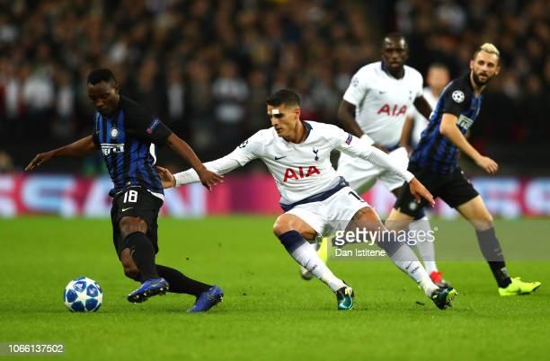 Kwadwo Asamoah of Inter Milan is challenged by Erik Lamela of Tottenham Hotspur during the UEFA Champions League Group B match between Tottenham...