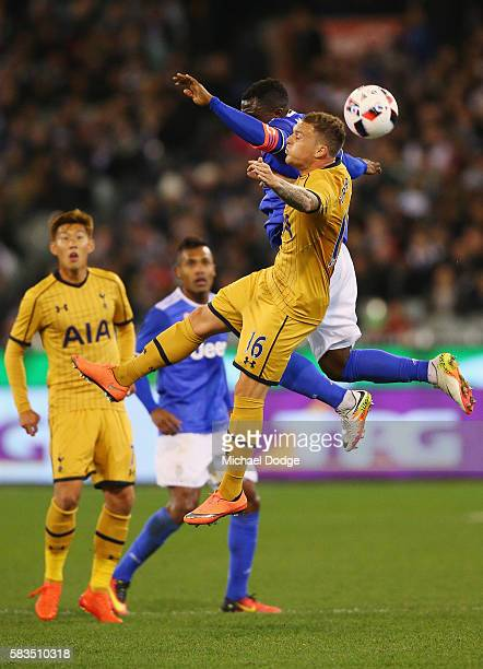 Kwadwo Asamoah of Juventus and Kieran Trippier of Tottenham compete for the ball during the 2016 International Champions Cup match between Juventus...