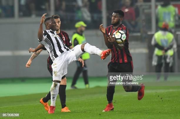 Kwadwo Asamoah of Juventus competes for the ball whit Franck Yannick Kessie of AC Milan during the TIM Cup Final between Juventus and AC Milan at...