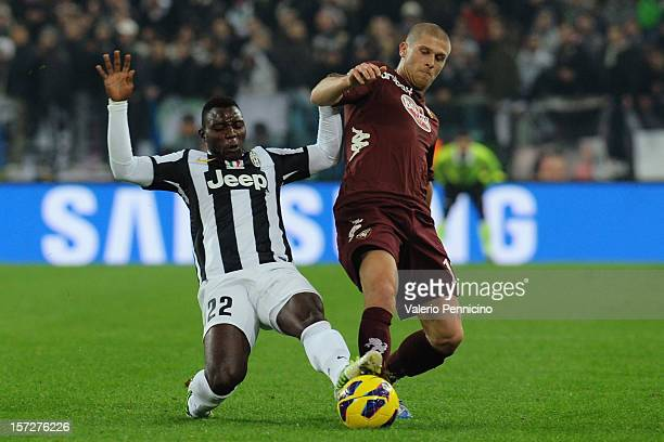 Kwadwo Asamoah of Juventus competes with Alen Stevanovic of Torino FC during the Serie A match between Juventus and Torino FC at Juventus Arena on...