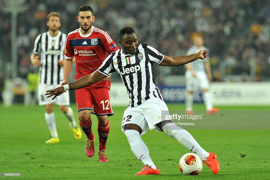 Kwadwo Asamoah of Juventus kicks the ball durig the UEFA Europa League quarter final match between Juventus and Olympique Lyonnais at Juventus Arena on April 10, 2014 in Turin, Italy.