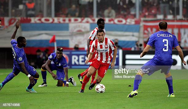 Kwadwo Asamoah Paul Pogba and Georgio Chiellini of Juventus competes with Omar Elabdelloul of Olympiacos FC during the UEFA Champions League group A...