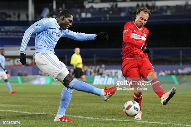 Kwadwo Poku NYCFC has his shot blocked by Michael Harrington Chicago Fire during the New York City FC Vs Chicago Fire MLS regular season match at...