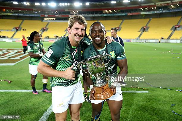 Kwagga Smith and Siviwe Soyizwapi of South Africa celebrate following the gold medal final match between Fiji and South Africa during the 2017...