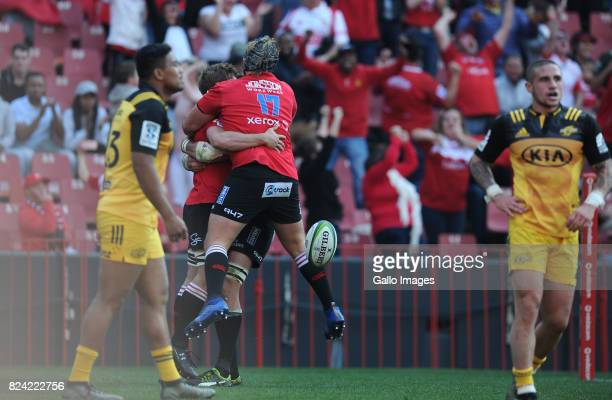 Kwagga Smith celebrating his try with Corne Fourie during the Super Rugby Semi Final match between Emirates Lions and Hurricanes at Emirates Airline...
