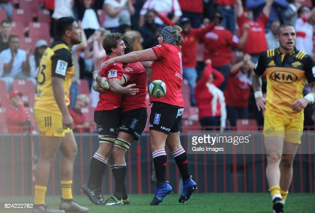 Kwagga Smith celebrating his try with team mates during the Super Rugby Semi Final match between Emirates Lions and Hurricanes at Emirates Airline...