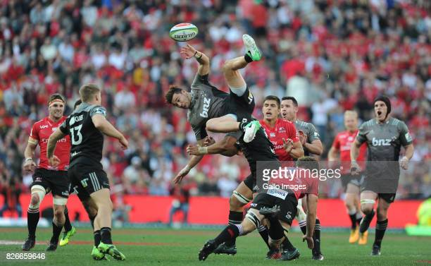 Kwagga Smith of Lions in midair with David Havili of Crusaders during the Super Rugby Final match between Emirates Lions and Crusaders at Emirates...