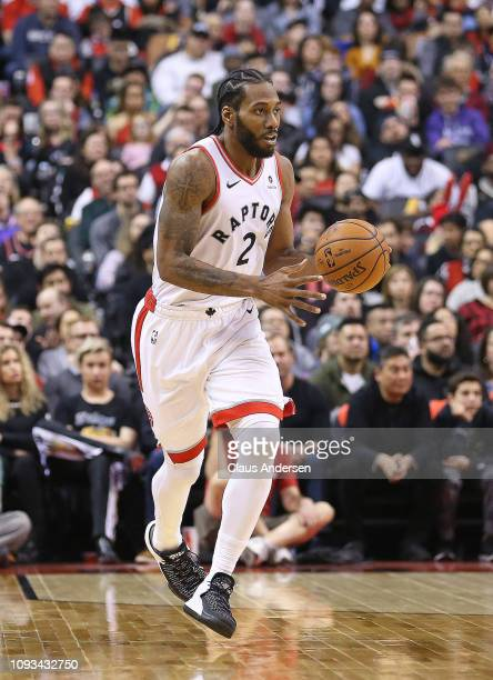 Kwahi Leonard of the Toronto Raptors brings the ball up court against the Los Angeles Clippers in an NBA game at Scotiabank Arena on February 3 2019...
