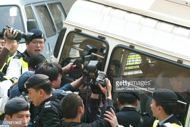 Kwai Pinghung Hong Kong's mostwanted armed robber facing charges of possession of arms and ammunition without a licence is escorted into court under...