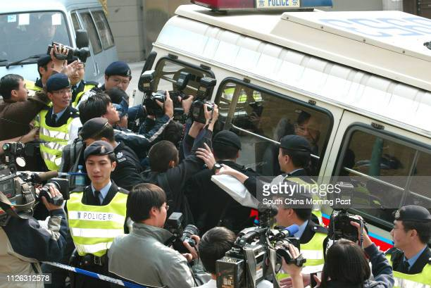 Kwai Pinghung Hong Kong's mostwanted armed robber is escorted into North Kowloon Court under tight police security More than 100 officers took part...