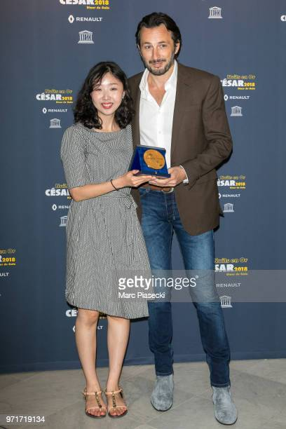 Kwak Eunmi and Michael Cohen attend the 'Les Nuits En Or 2018' dinner gala at UNESCO on June 11 2018 in Paris France