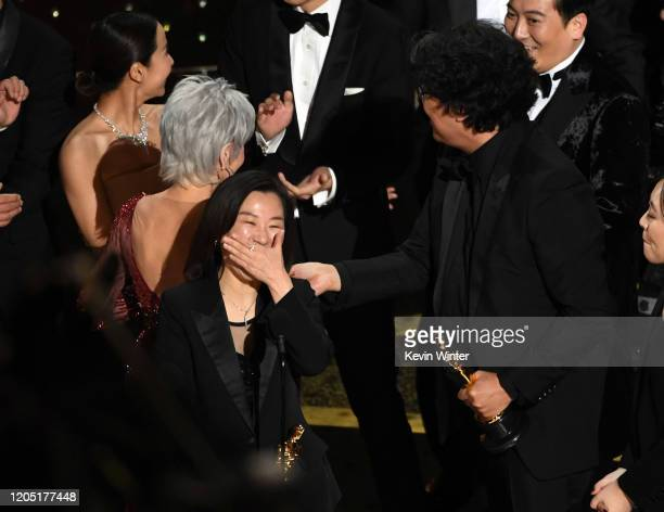 Kwak Sinae and Bong Joonho accept the Best Picture award for 'Parasite' onstage during the 92nd Annual Academy Awards at Dolby Theatre on February 09...
